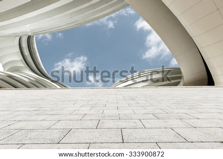 Empty square floor with skyline and buildings - stock photo