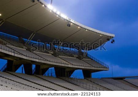 Empty stadium with lights on - stock photo