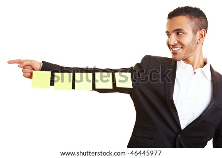 Empty sticky notes on an arm pointing to the left - stock photo
