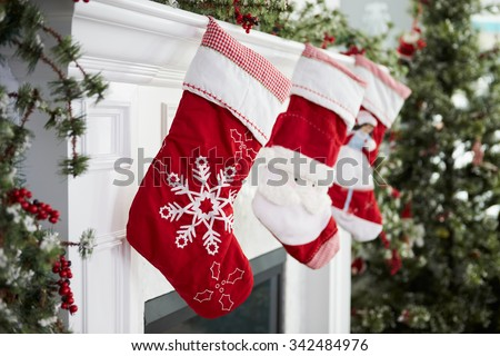 Empty Stockings Hung On Fireplace On Christmas Eve - stock photo