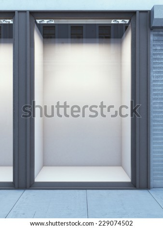 Empty storefront of shop with white wall - stock photo