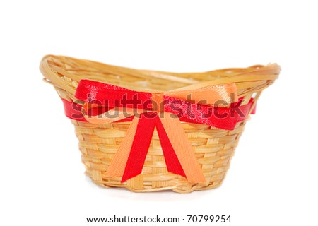 empty straw basket with a red-orange bow isolated on white