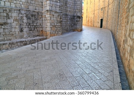 Empty street between historical buildings in the old town of Dubrovnik, Croatia - stock photo