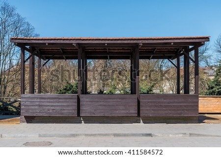 Empty street market wooden stall on sidewalk - stock photo