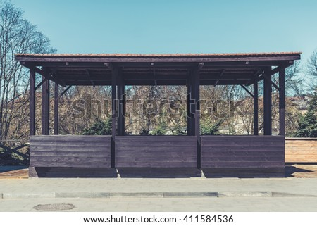 Empty street market wooden stall on sidewalk. Vintage effect filter style - stock photo