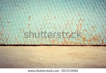 Empty street metal weathered rusty wall with ground floor - stock photo