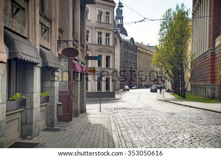 Empty streets of the old town of Riga pavers early summer morning - stock photo