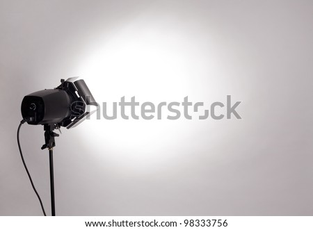 empty studio background and flash light on light grey