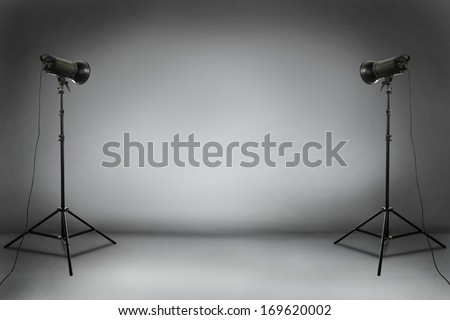 empty studio of gray and two black lamps  - stock photo