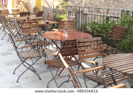 empty summer cafe in the street