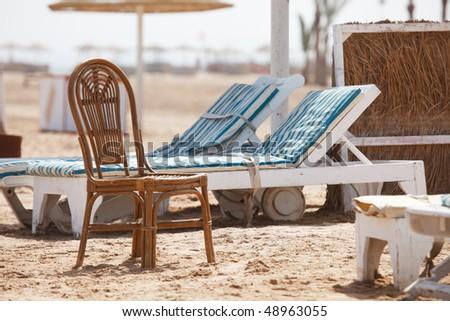 Empty sunbeds in empty beach - stock photo