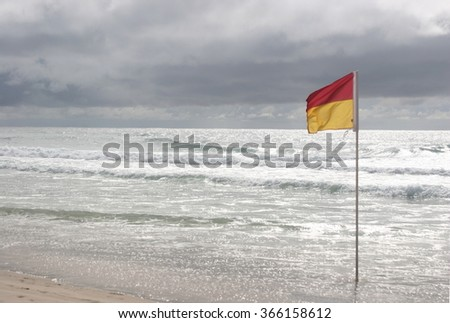 Empty surfers paradise beach before an imminent storm, Gold Coast, Australia.  Suitable for stormy weather, or gloom and doom scenes - stock photo