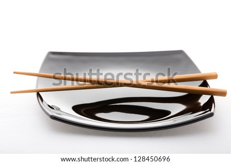 empty sushi set, plateaus and chopsticks isolated on white background - stock photo