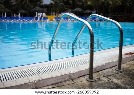 Empty Swimming Pool Ladder Close-up - stock photo