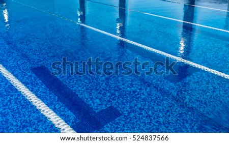 Empty swimming pool with clean blue water