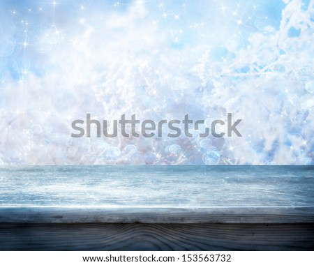Empty table and winter background - stock photo