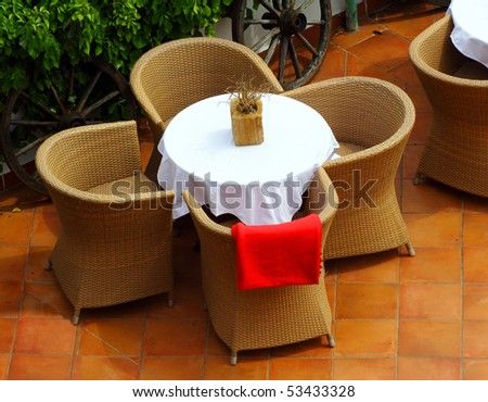 Empty table in open air restaurant. - stock photo