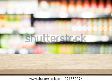 Empty table over blur supermarket with bokeh background, Product shelf - stock photo