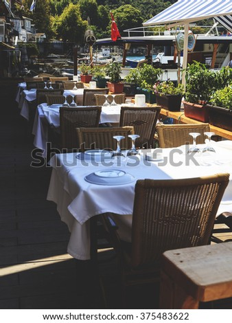 Empty tables at an outdoor restaurant - stock photo