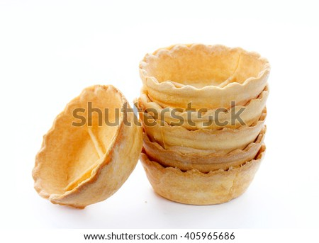 Empty tartlets isolated on white background