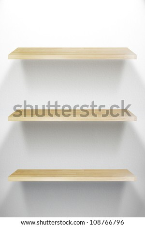 Empty three wood Shelf on white wall - stock photo