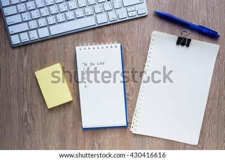empty to do list with pen, post it, blank paper sheet and keyboard - stock photo
