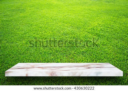 Empty top marble shelves and green grass wall background / for product display montage product display