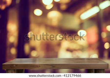 Empty top of natural wooden table and blur with bokeh background. use for product display - stock photo