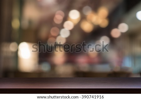 Empty top of wooden table, shelf or counter on cafeteria, bar, pub, coffeeshop background. For product display - stock photo