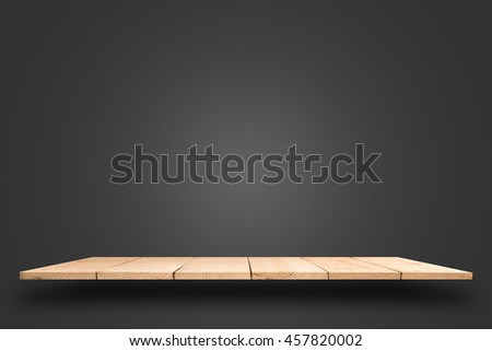 empty top wooden shelf on black background.  For product display