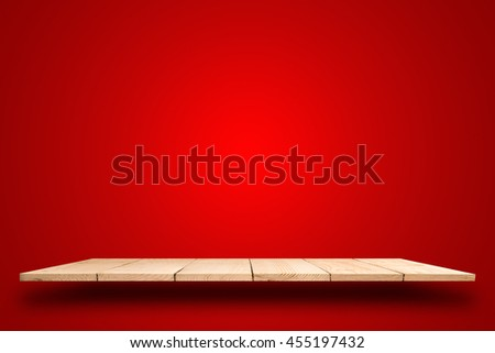 empty top wooden shelf on red background.  For product display