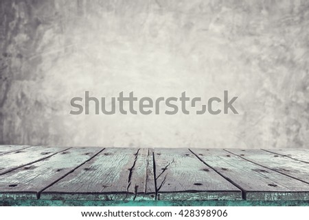 Empty top wooden table on stone wall background. For product display
