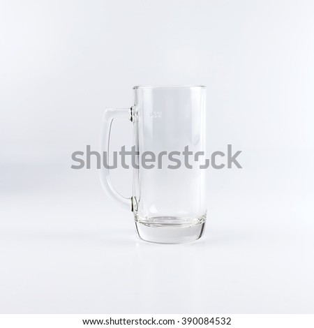 Empty traditional beer mug against white background - stock photo