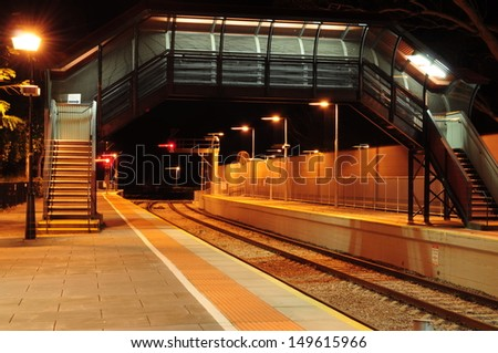 Empty Train Station at Night. Pedestrian walkway - stock photo