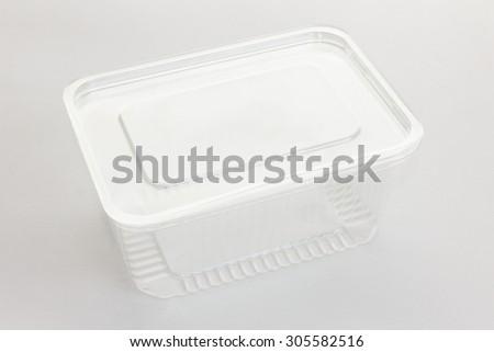 Empty transparent plastic storage box of food on white - stock photo