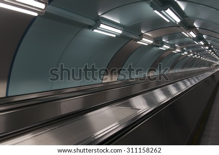 empty travelator and reflection