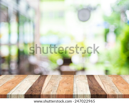 Empty tropical wood table and blurred garden cafe light background. product  display template.Business