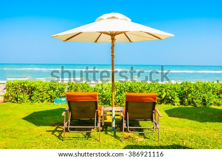 Empty Umbrella and chair around swimming pool in hotel resort