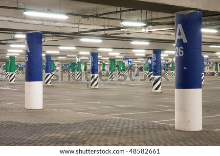 Empty underground parking at night in Moscow - stock photo
