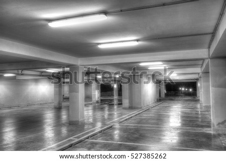 Empty underground parking garage (black and white)