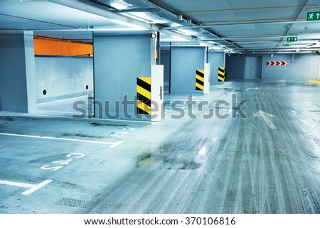 Empty underground parking with lots for cars - stock photo