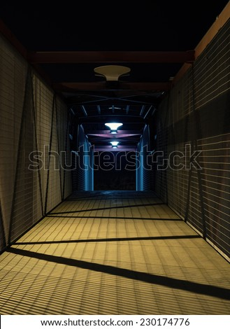 Empty urban night scene.  Metal bridge tunnel.