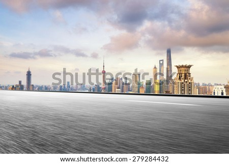 Empty urban road and buildings - stock photo