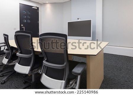 Empty video conference room focus at camera - stock photo