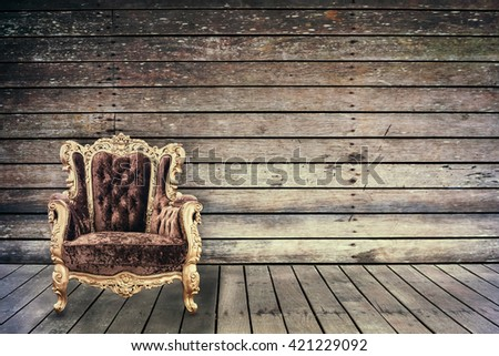 Empty vintage chair in grunge old wooden room - stock photo