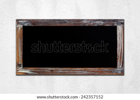 Empty vintage chalk board on white cement wall background, wording template - stock photo