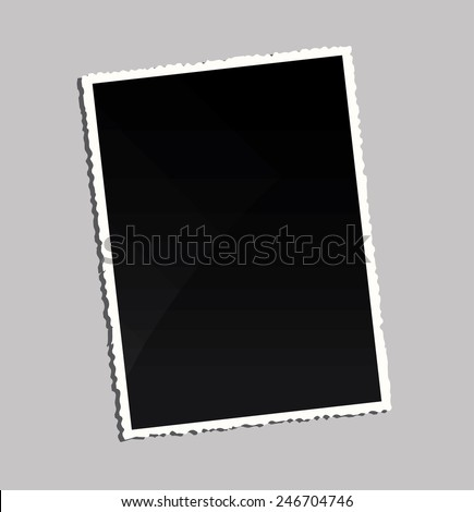Empty vintage photo frame on table  - stock photo