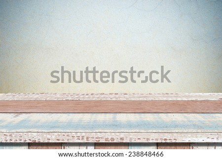 Empty vintage table over grunge cement wall, vintage, background, template, display - stock photo