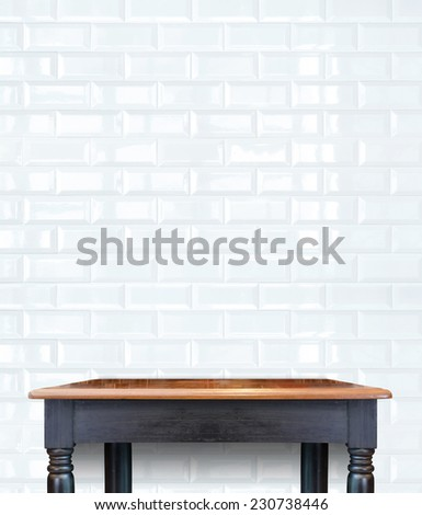 Empty Vintage Wooden Table top at white tile ceramic wall,Template mock up for display of your product