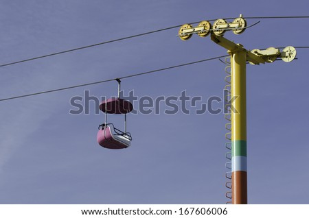 Empty violet ropeway - chairlift - gondola - stock photo